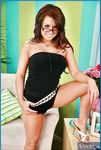 Грудастая девушка в очках с татуировкой на пояснице Eva Angelina