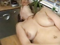 German hairy bitch plays with cucumber