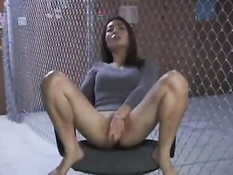 Asian girl doing herself on a chair