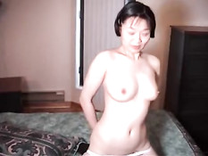 Asian playing in bed