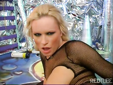Bitch in fishnet bodystocking works her pussy