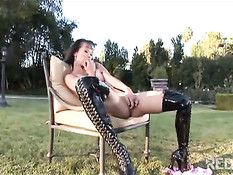 Asian babe in tighhigh patent leather boots