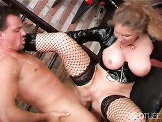 Mature dominatrix uses her slave