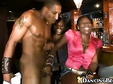 Girls enjoying show of naked stripper