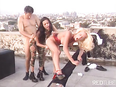 Two babes playing with one dick