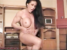 Muscled Lady Gives A Strip Show