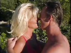 Lifeguard Couple Having Fun In The Garden