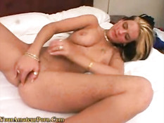 Hot blonde playing with her toy