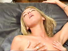 Blond girls licking on leather couch