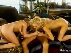 Two blondes blowing