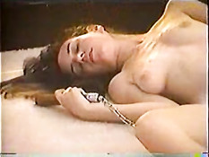 Young woman masturbating with nunchaku
