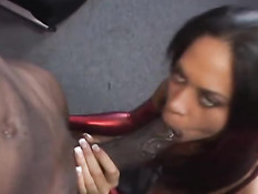Sucking on a black cock