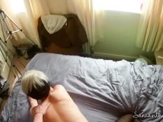 Мужик ебёт на кровати молодую сисястую блондинку в чёрных колготках