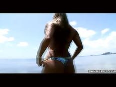 Busty bikini chick shows all she has