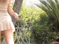 Blond babe doing outdoor strip